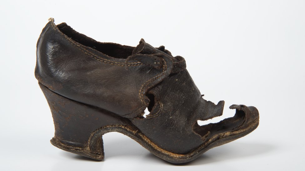 Woman's latchet tie shoe, 1675-99. Found bricked up in a wall after investigating death watch beetle in Ely Cathedral