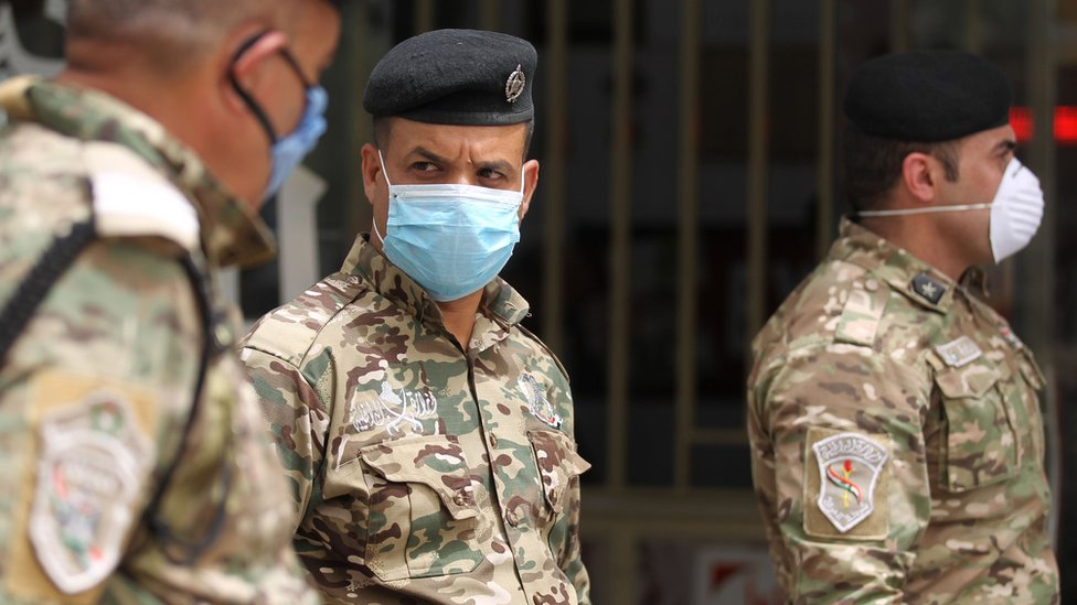 Iraqi security forces wear masks in central Baghdad on 5 May 2020
