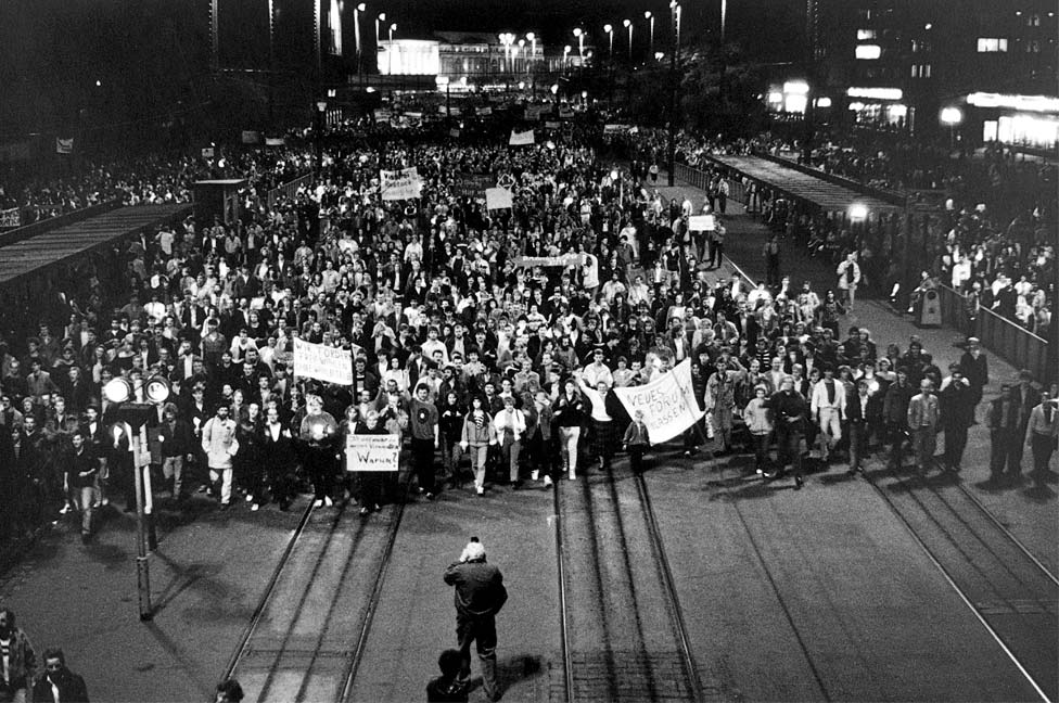 Demonstrators march through Leipzig in 1989