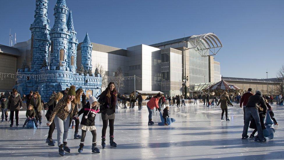 People ice skating at winter wonderland event