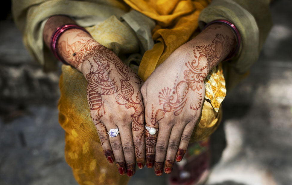 Indian women often decorate their hands with henna on their wedding day