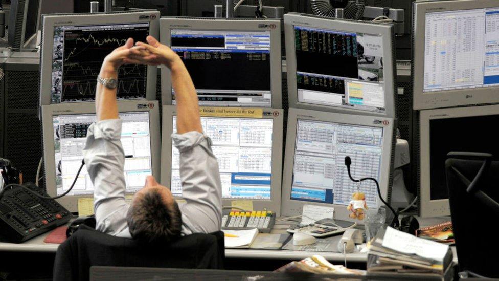 Banker stretching at desk