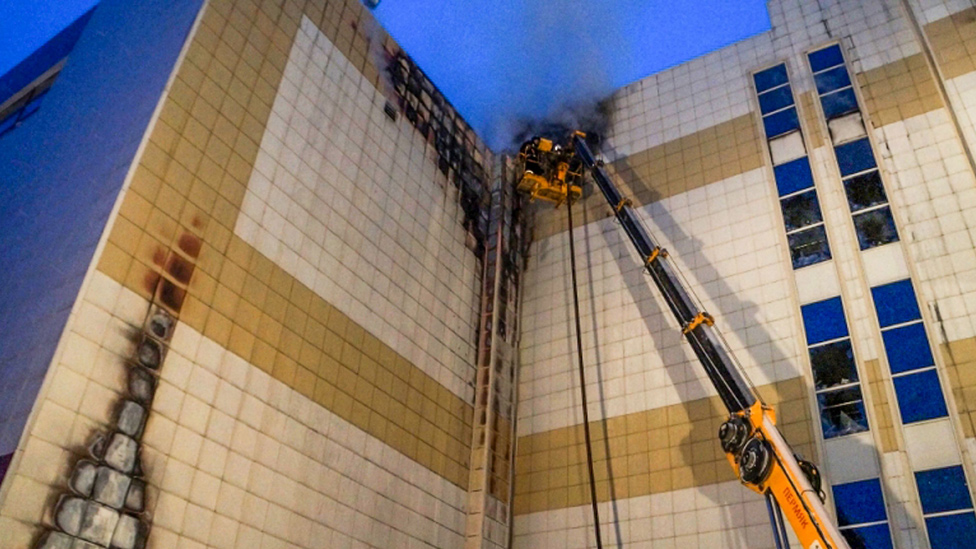 Firefighters extinguish a fire at a shopping mall in Kemerovo, Russia, 25 March 2018