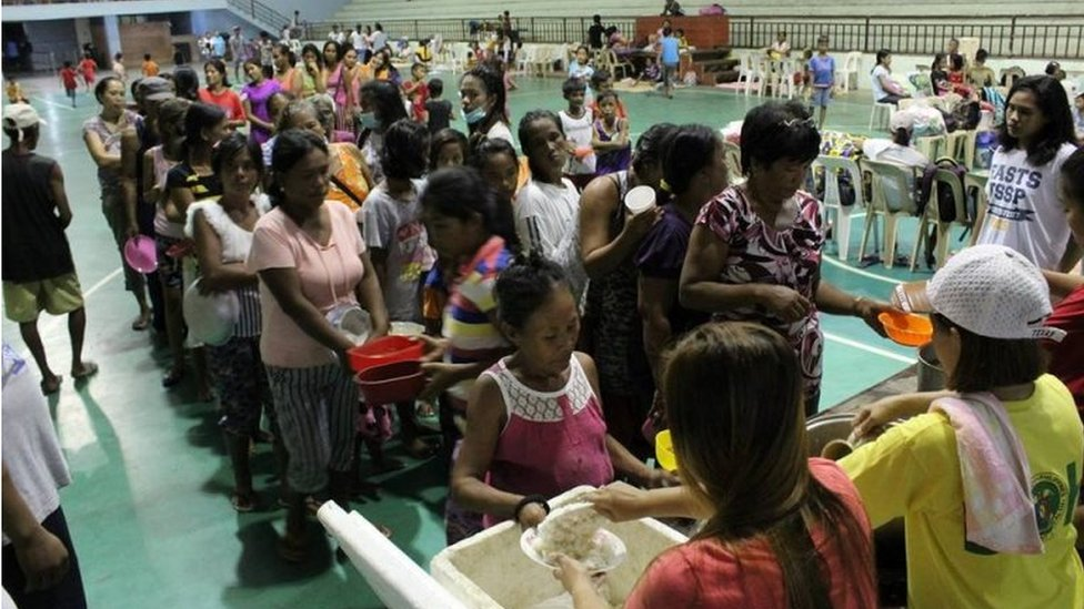 People are seen inside an evacuation centre in preparation for Typhoon Mangkhut in Cagayan, Philippines, in this September 13, 2018 photo by LGU Gonzaga Cagayan from social media.