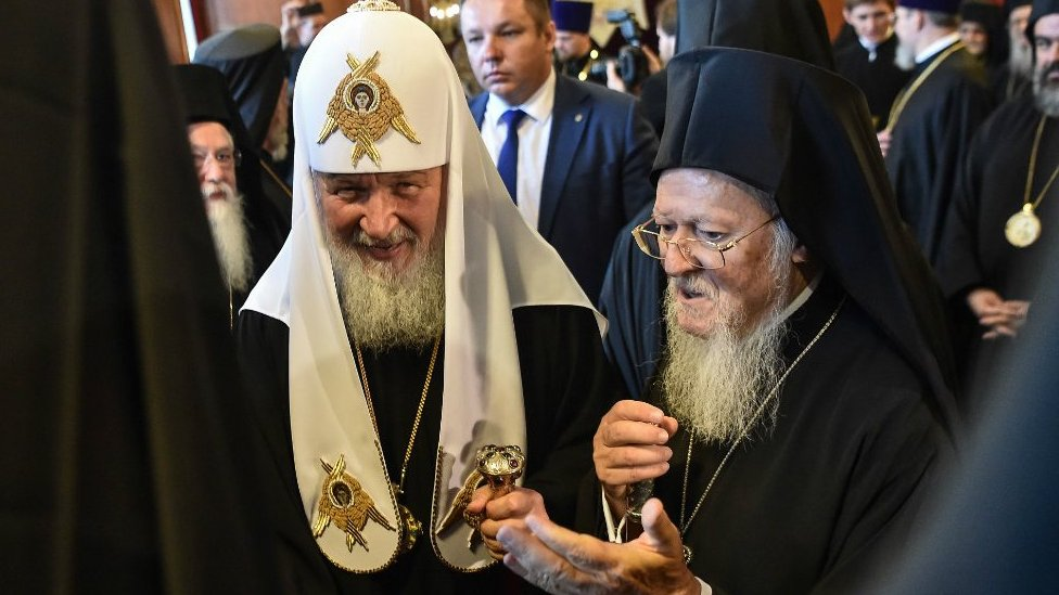 Greek Orthodox Ecumenical Patriarch Bartholomew I (R) and members of the clergy greet Patriarch of Moscow and All Russia Kirill (C) at St George church, the main Greek Orthodox cathedral during his visit on August 31, 2018 in Istanbul.