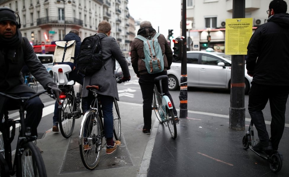 People ride bikes on the streets of Paris during a strike by French SNCF railway workers on 5 December, 2019