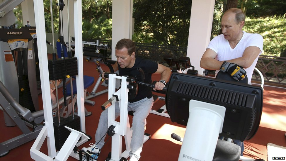 Russian President Vladimir Putin (R) and Prime Minister Dmitry Medvedev exercise in a gym at the Bocharov Ruchei state residence in Sochi, Russia, August 30, 2015.