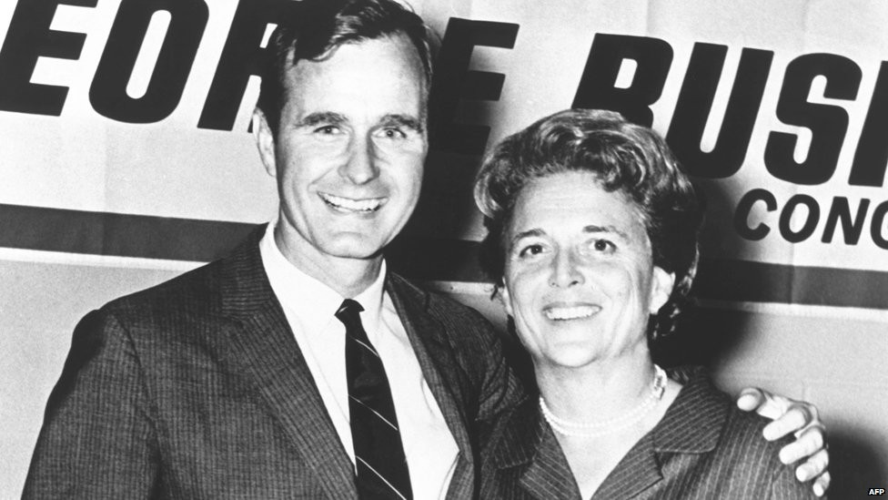 George HW Bush poses with his wife Barbara during his campaign for Congress in the 1960s.
