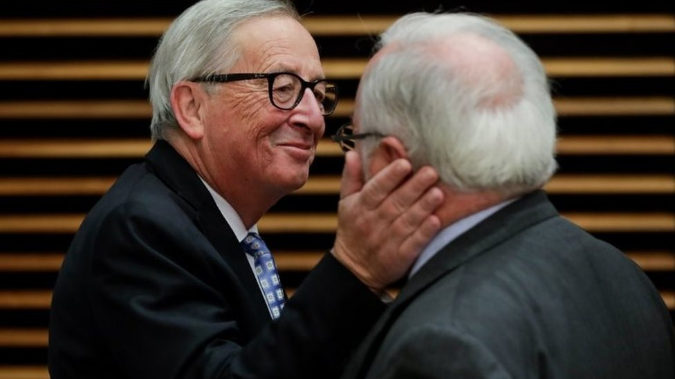 Jean-Claude Juncker playfully slaps fellow EU Commissioner Miguel Arias Canete at a Commission meeting in October, 2019