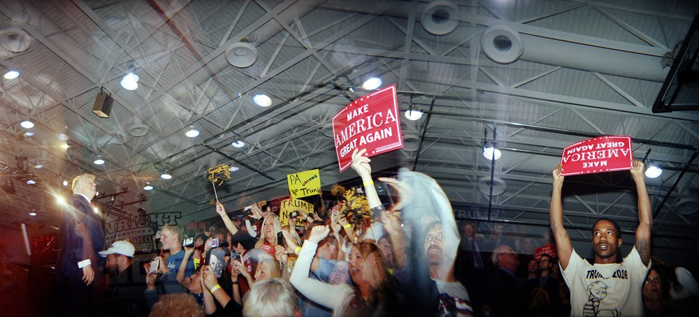 The crowd cheers as Donald Trump walks on stage at his rally in Ambridge, Pennsylvania, 10 October 2016