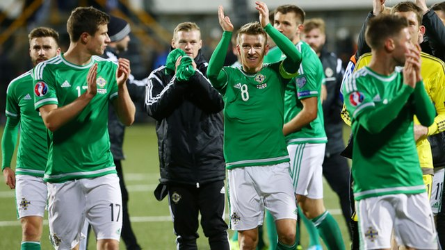 Northern Ireland players celebrate after beating the Faroe Islands