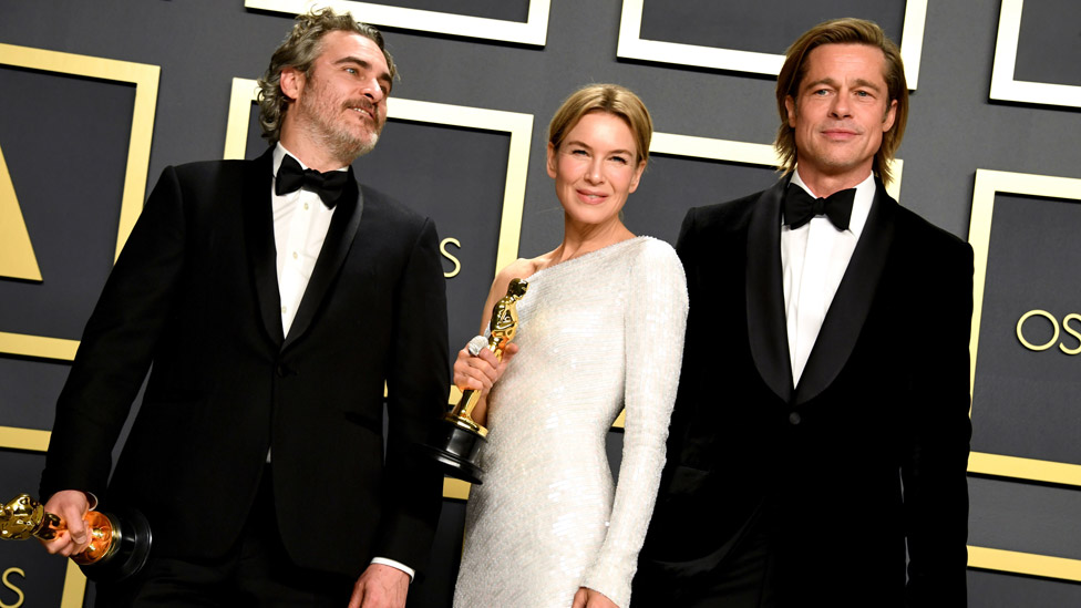 Joaquin Phoenix, Renee Zellweger and Brad Pitt with their statuettes