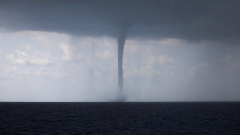 Huge waterspout hits Italy's south-western city