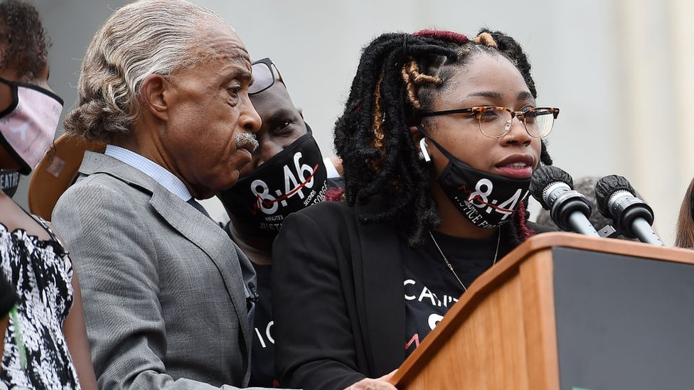George Floyd's sister Bridgett Floyd speaks as Rev Al Sharpton and Philonise Floyd listen during the March on Washington at the Lincoln Memorial on August 28, 2020 in Washington, DC