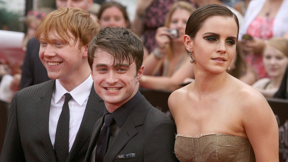 """Actors Rupert Grint, Daniel Radcliffe and Emma Watson attend the premiere of """"Harry Potter and the Deathly Hallows - Part 2"""" at Avery Fisher Hall, Lincoln Center on 11 July, 2011 in New York City."""