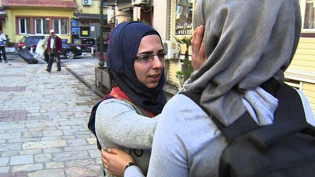 Syrian women saying goodbye