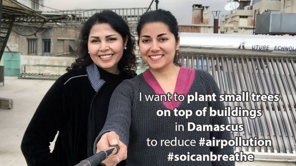 "Areej and Hala in Damascus with the phrase ""I want to plant small trees on top of buildings in Damascus to reduce #AirPollution #SoICanBreathe"""