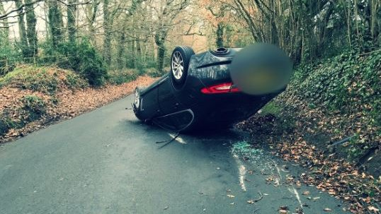Child rescued from overturned car in Devon
