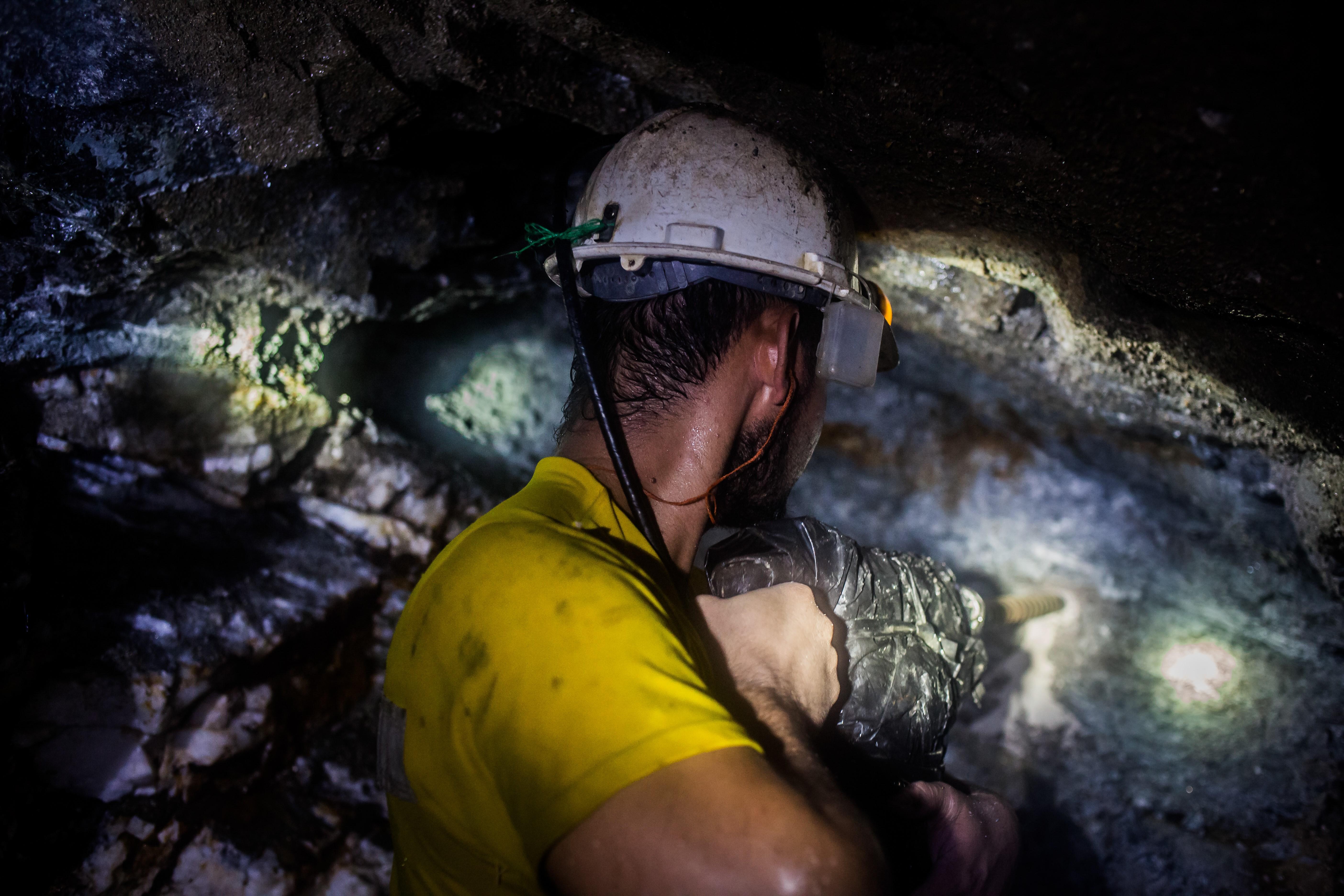 A worker in an underground gold mine.