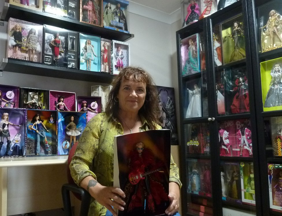 Linda Richardson with some of her Barbie collection