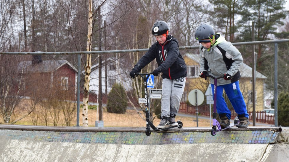 Kids on their scooters at Hauho Comprehensive School, Finland