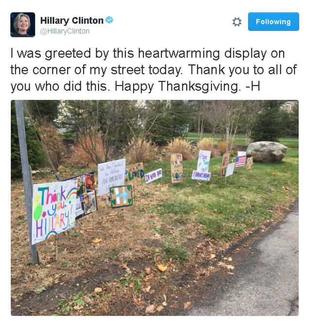 Tweet reads: I was greeted by this heartwarming display on the corner of my street today. Thank you to all of you who did this. Happy Thanksgiving. -H