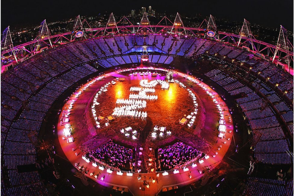Performers pay tribute to the National Health Service (spelling out NHS) during the Opening Ceremony of the London 2012 Olympic Games
