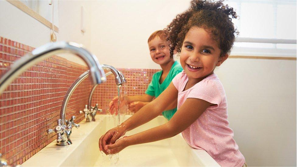 Children washing hands in school