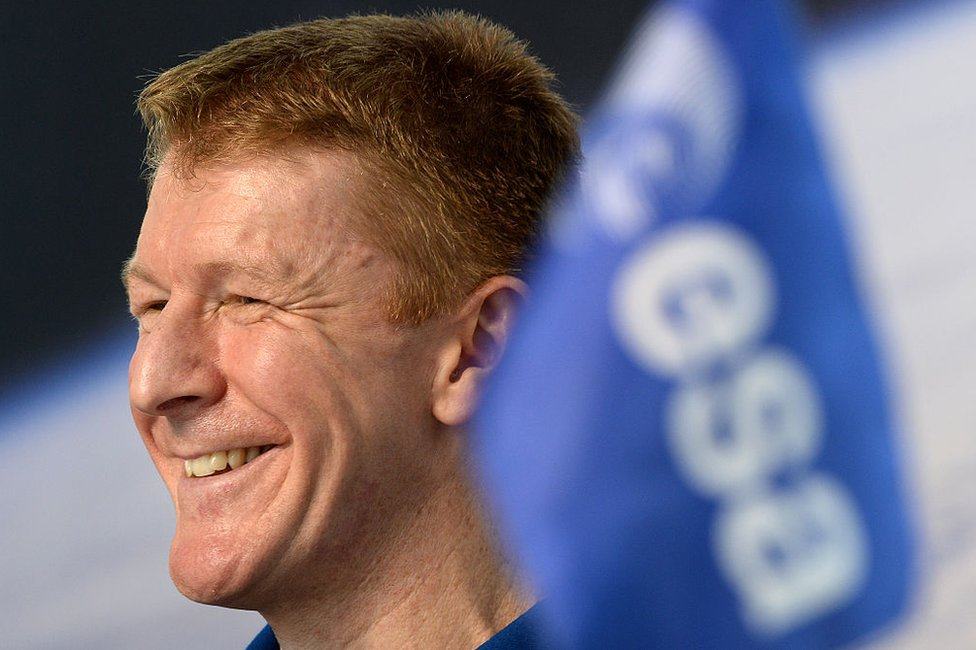 British astronaut Tim Peake with a European Space Agency flag