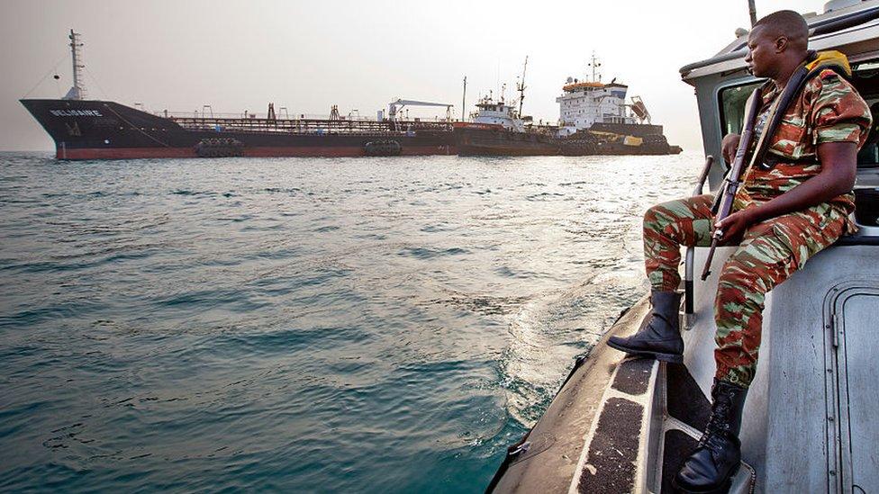 A Beninese anti-piracy guard patrolling the sea