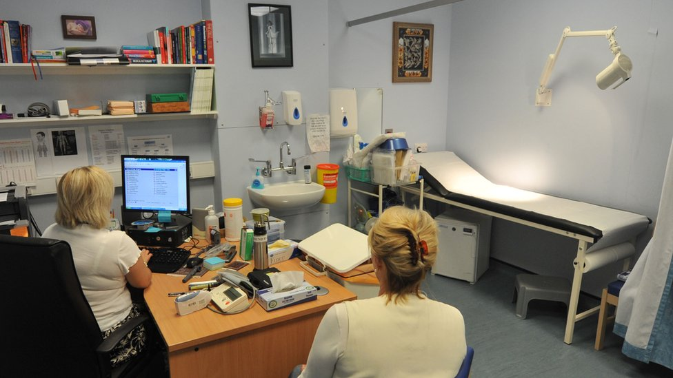 woman attends GP appointment