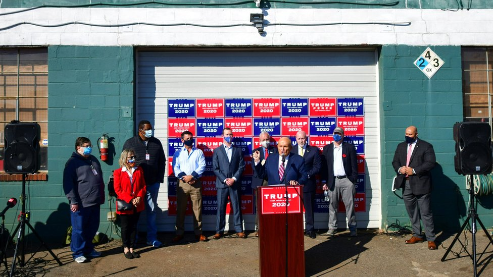 Rudy Giuliani gives a news conference outside a landscaping centre
