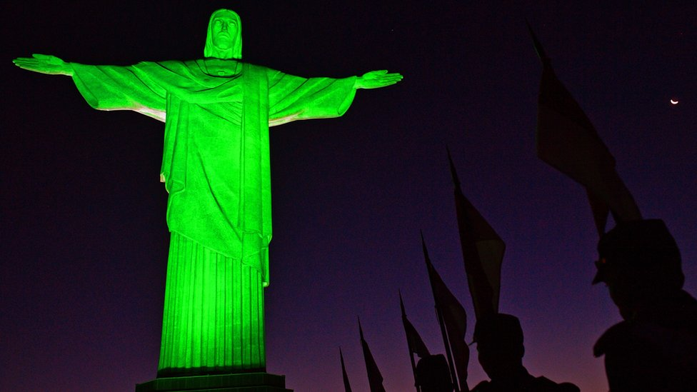 Soldiers in ceremonial costume line up in front of Christ the Redeemer statue in Rio de Janeiro