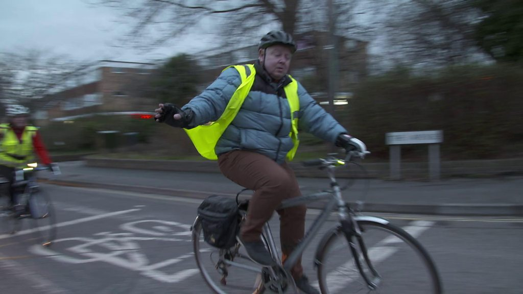 Crossing Divides: A motorist swaps places with a cyclist