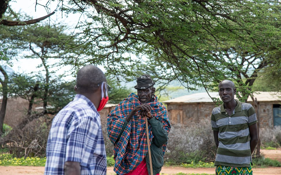 The helicopter crew stop to speak with communities
