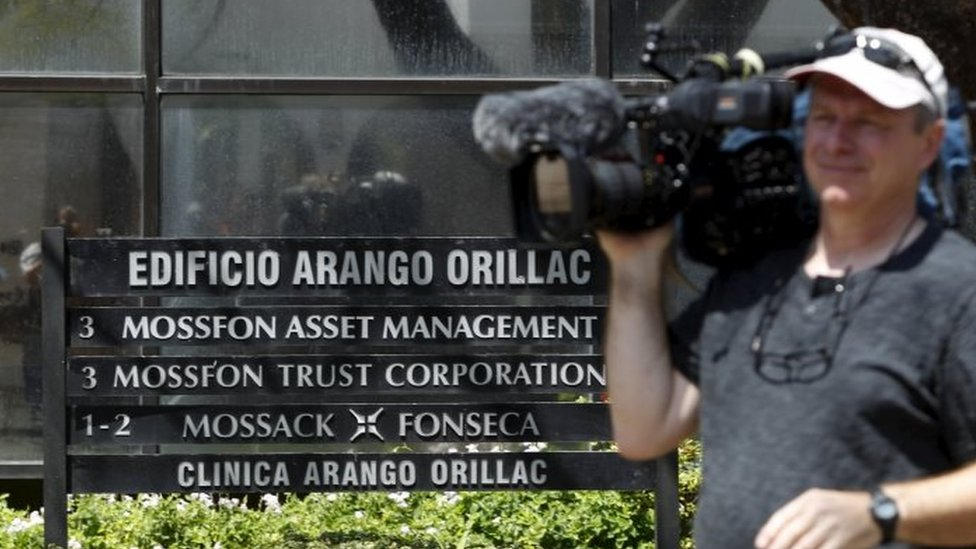 A cameraman is seen outside the Arango Orillac Building where Mossack Fonseca law firm is situated in Panama City (05 April 2016)