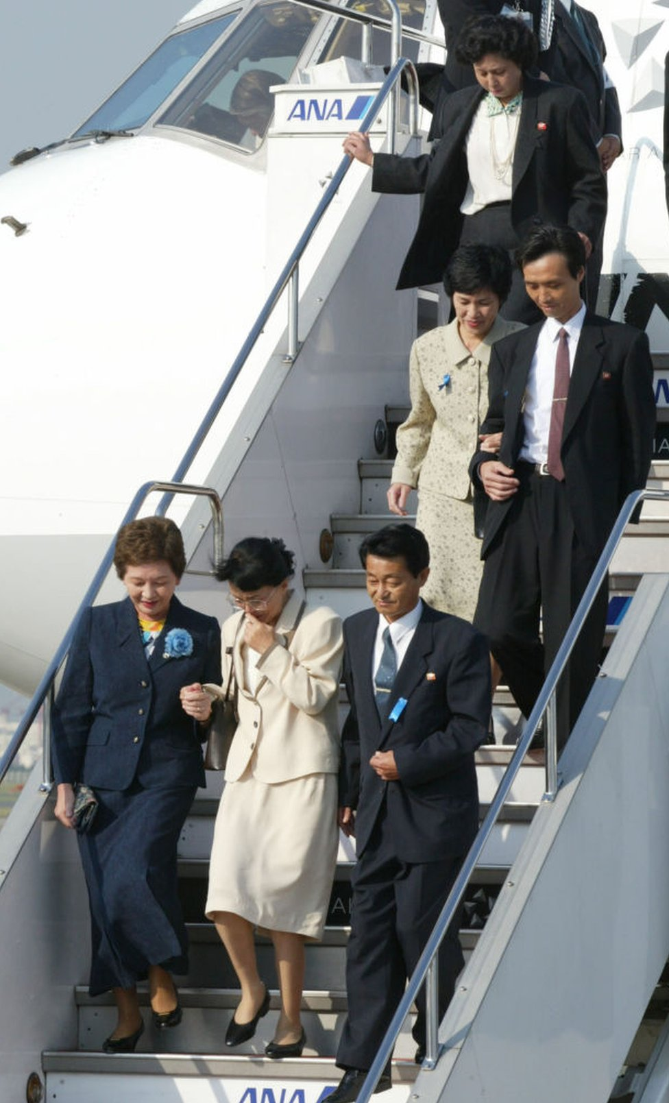 Five Japanese nationals, abducted to North Korea in the 1970s and 80s, arrive at Tokyo's Haneda Airport on October 15, 2002