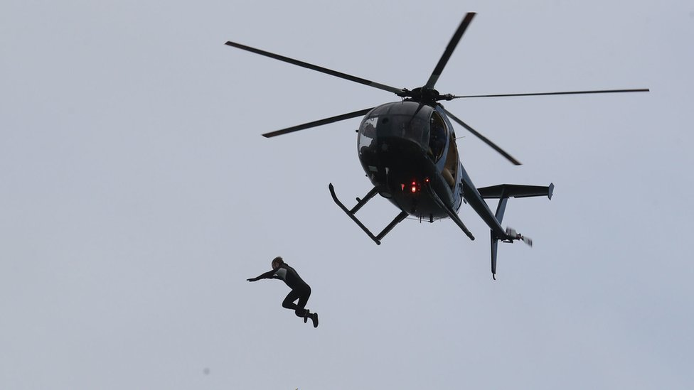 John Bream jumps from helicopter