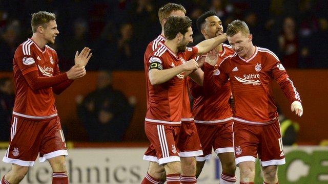 Aberdeen celebrate Jonny Hayes' opening goal against Celtic