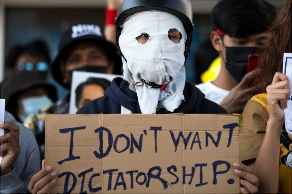 A demonstrator holds a placard during a rally against the military coup and to demand the release of elected leader Aung San Suu Kyi, in Yangon, Myanmar, February 10, 2021.