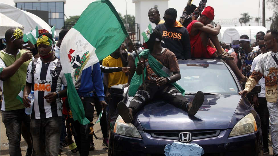 End Sars protesters on a car with a Nigerian flag in Lagos, Nigeria 1- October
