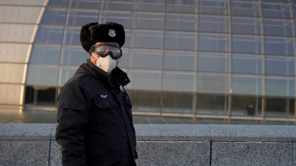 A security guard wears a mask in Beijing