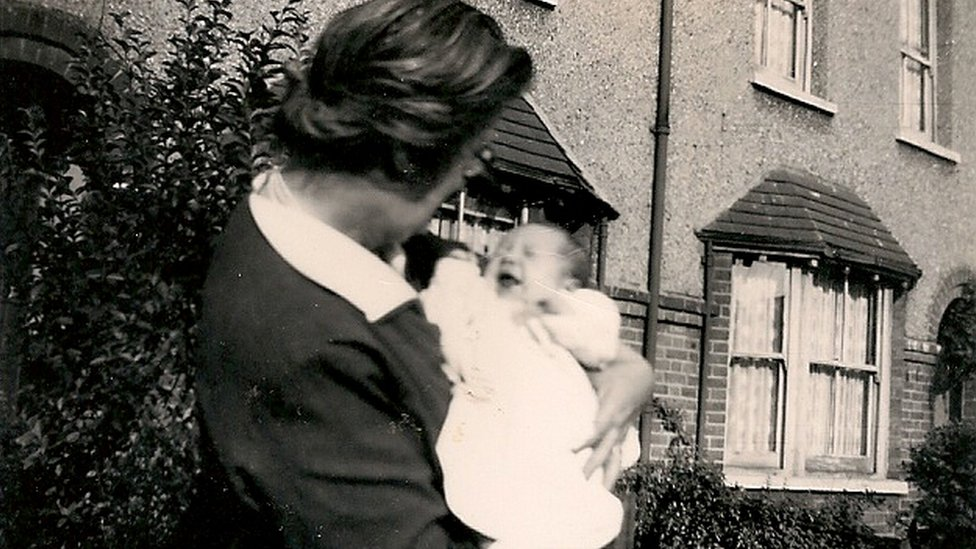 Kevin Crossland pictured with his grandmother in 1961, the year he was born