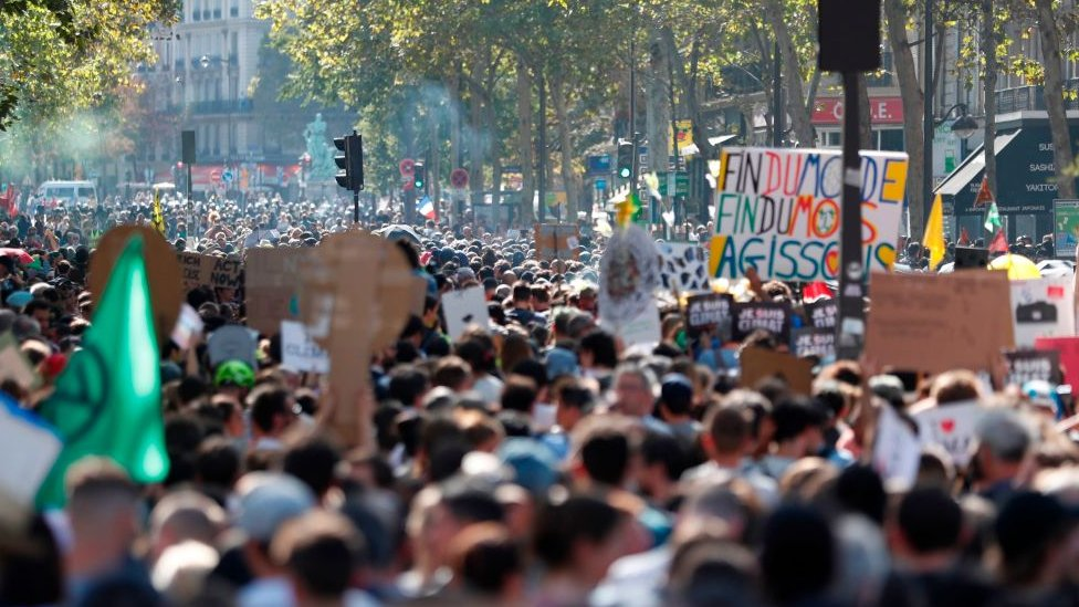 The climate change march gathered on the Champs Elysees