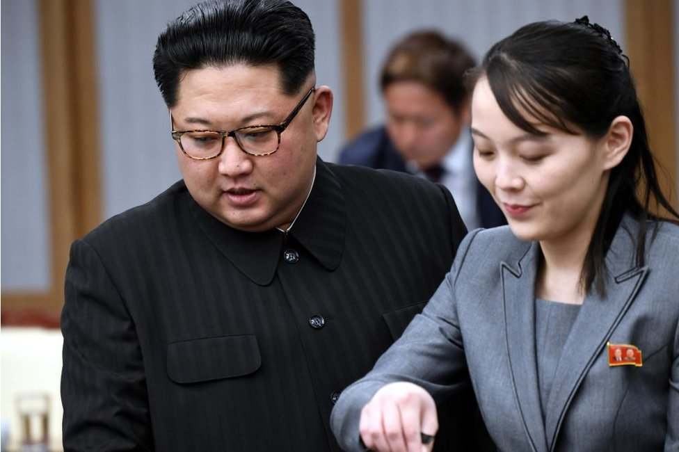 North Korean leader Kim Jong Un (L), alongside Kim Yo Jong, his sister and a senior official of the ruling Workers' Party, attends a meeting with South Korean President Moon Jae In