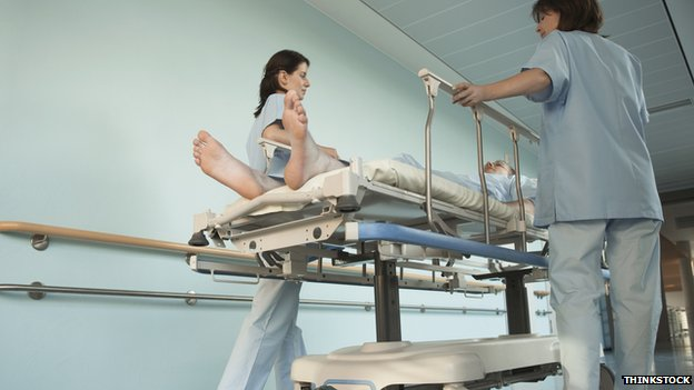 Nurses moving patient