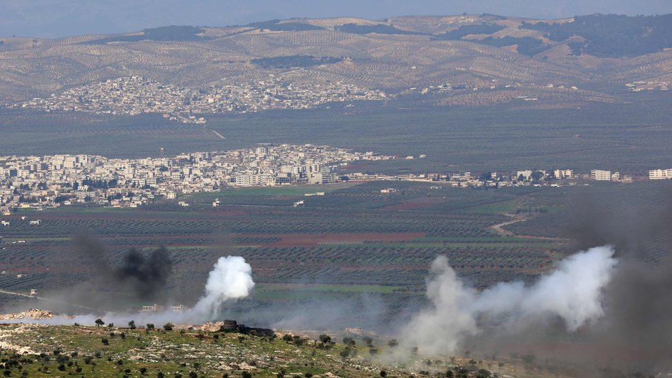 Turkish-backed Syrian rebels fire based in southern Turkey fire towards Kurdish YPG militia fighters in the Afrin region, on 19 February 2018
