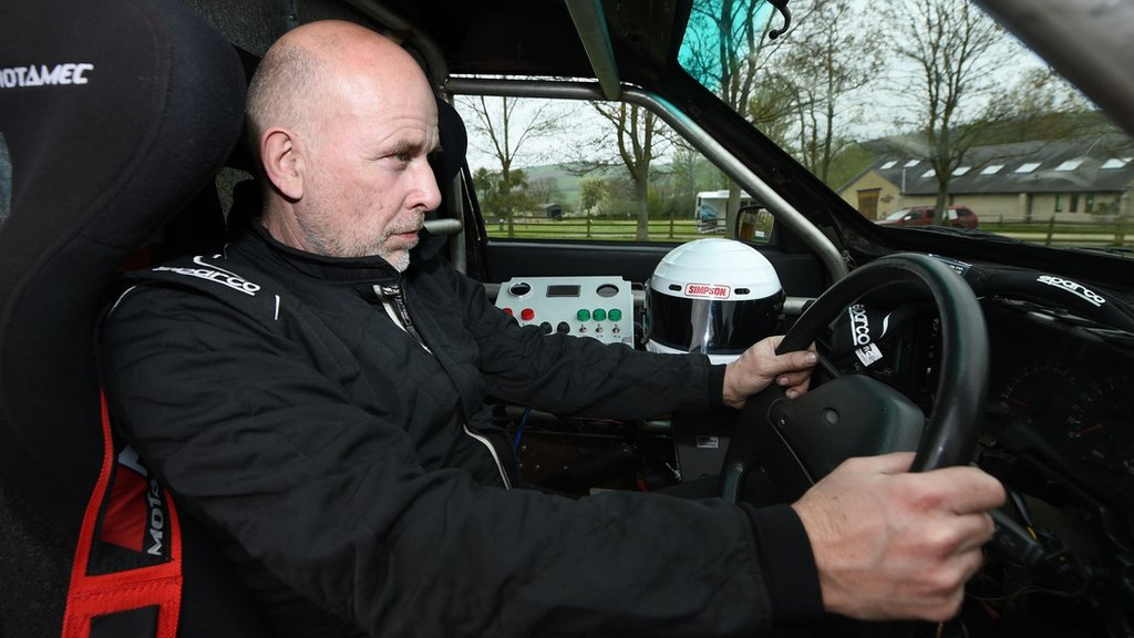 """Matt McKeown at the wheel of his converted 1992 Ford Cardinal hearse """"Dead Quick"""" at the Prescott Hill Climb in Gloucestershire."""