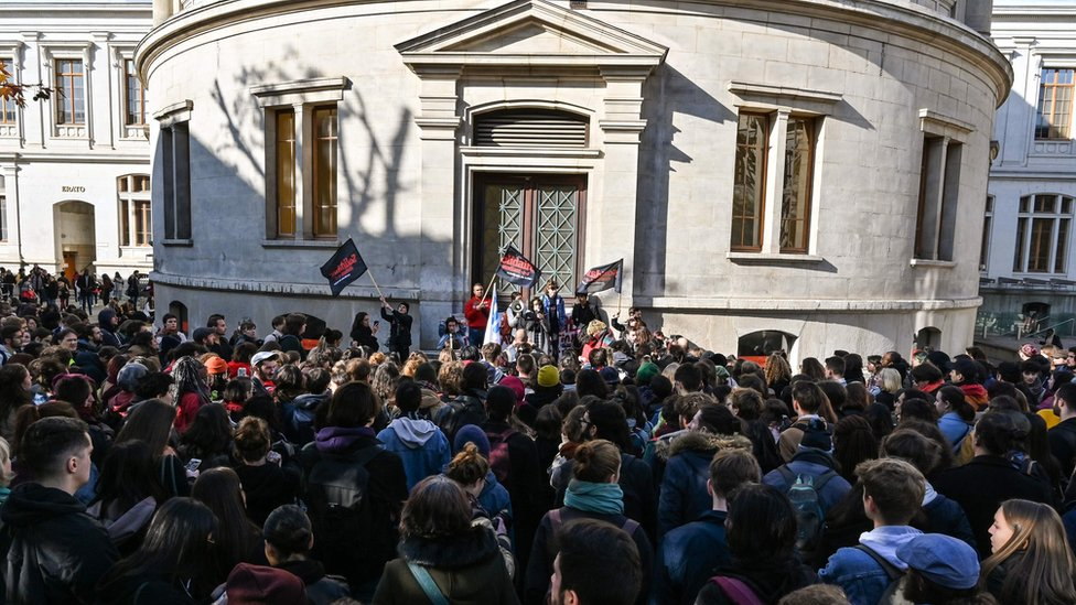Students gather inside the campus of Lyon 2 building in Lyon on November 12, 2019 during a demonstration called by French students union Solidaires days after a 22-year-old student set himself on fire over financial problems.