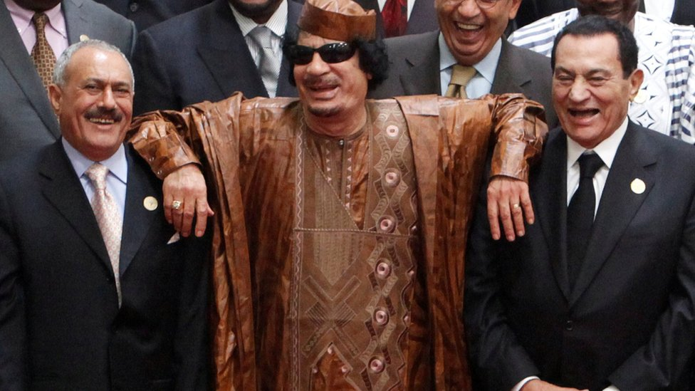 Then Libyan leader Muammar al-Gaddafi (C) leans on the shoulders of then Egyptian President Hosni Mubarak (centre R) and then Yemeni President Ali Abdullah Saleh (centre L) at the second Afro-Arab Summit in Sirte, Libya (10 October 2010)
